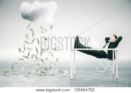 Financial growth concept with businessman sitting at table with feet up and looking at abstract money rain. 3D Rendering