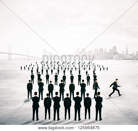 Different deirection concept with arrow shaped crowd of businesspeople going in one direction and just one person walking away