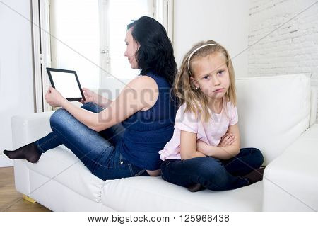 internet network addict mother using digital tablet pad ignoring little sad daughter left alone bored and depressed feeling abandoned and disappointed with mum in parent bad selfish behavior