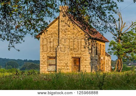 An Old Abandonded Texas Homestead Farmhouse in a Beautiful Field Full of Various Texas Wildflowers.