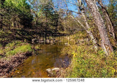 A Tranquil Autumn Outdoor Scene of a Clear Rocky Creek at Robbers Cave State Park in Oklahoma.