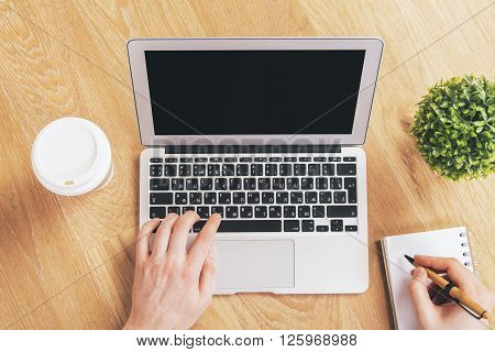 Hands Using Black Laptop