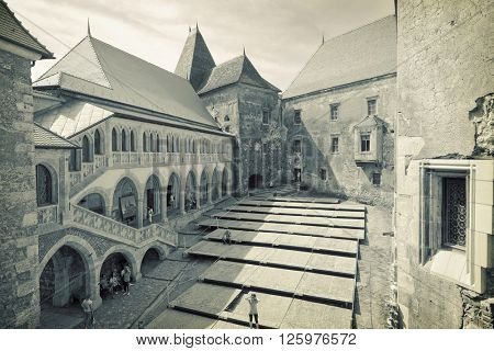 HUNEDOARA, ROMANIA - AUGUST 13, 2015: inner courtyard of medieval Corvin Castle in Hunedoara, one of the largest castles in Europe