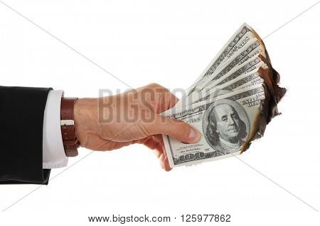 Male hand holding burning dollar banknotes, isolated on white