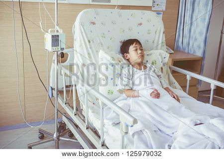 Illness Asian Child Admitted In The Hospital With Infusion Pump Intravenous Iv Drip. Vintage Style.