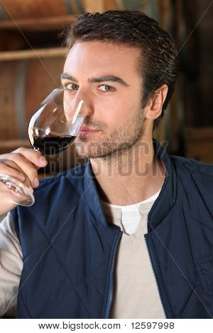 Winegrower with glass of red wine