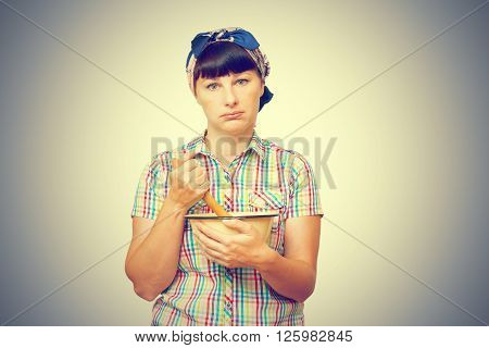 Tired Woman With Utensils In Hand