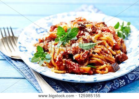 Spaghetti with vegan Bolognese sauce,  Parmesan cheese and Greek Basil