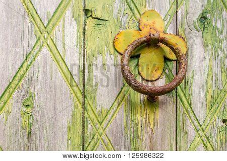 Door handle-knocker on old wooden door in Kyrenia Cyprus