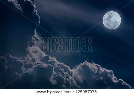 Attractive photo of a nighttime sky with clouds bright full moon would make a great background. Nightly sky with large moon. Beautiful nature background. Outdoors.