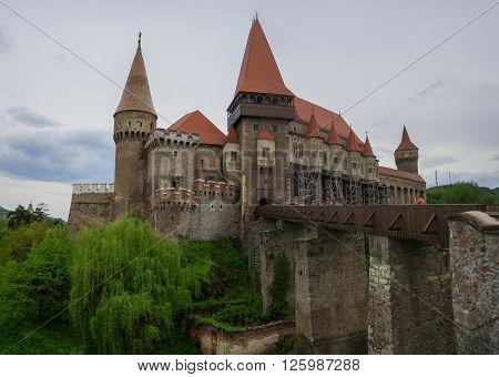 Beautiful panorama of the Corvin castle with wooden bridge and bench. Hunedoara,Transylvania, Romania, Europe