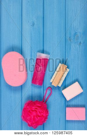 Cosmetics and accessories for personal hygiene in bathroom soap body scrub sponge bath puff brush pumice concept of body care copy space for text
