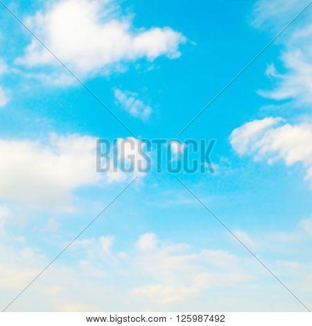 ? blue sky and white cumulus clouds