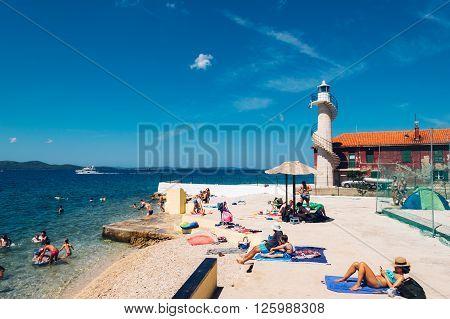 Zadar, Croatia - July 28, 2015: Tourists Swim In The Adriatic Sea Near Zadar On Sunny Day.