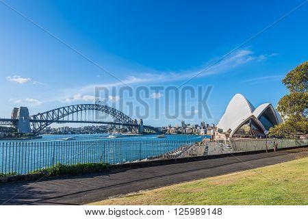 Sydney Australia - November 7 2014: Sydney's most famous landmark - The Harbour Bridge The Sydney Opera view from Royal Botanic Garden Sydney NSW Australia.