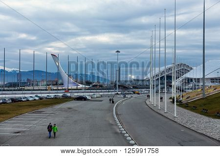 Sochi, Russia - February 5, 2016: Square with bowl of the olympic flame and Fisht stadium in the olympic park