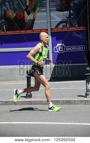 BELGRADE, SERBIA - APRIL 16: An unidentified man runs in 29th Belgrade Marathon on April 16, 20116 in Belgrade, Serbia
