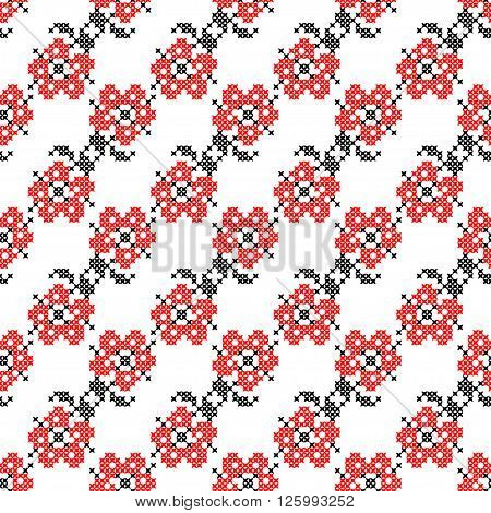 Seamless isolated texture with abstract red embroidered flowers with leaves for tablecloth. Embroidery. Cross stitch.