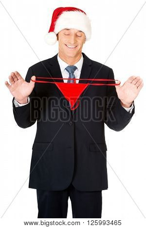 Santa businessman stretching female thongs