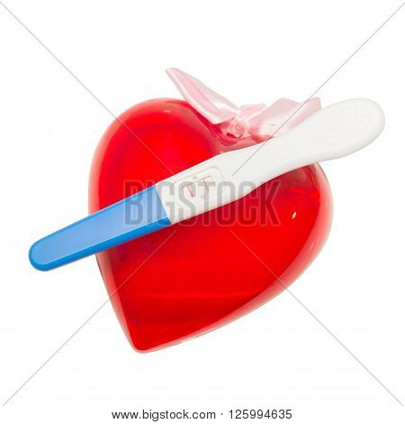 Positive pregnancy test and heart on white background, Pregnant concept, Pregnant idea, Pregnant health care, Pregnant Hygienic, Pregnant healthy.