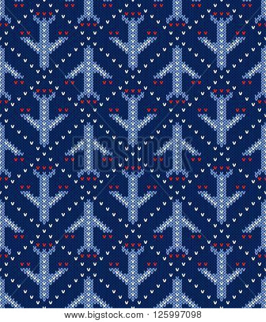 Knitted pattern of the flying planes on a blue background. Concept of air flights travel. Handwork ornament. Seamless pattern. Vector illustration.