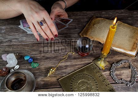 Fortune teller woman predicting future from tarot cards