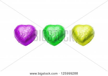 Three color chocolate hearts candy on white background