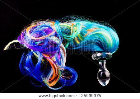 miny pony anal plug in black background