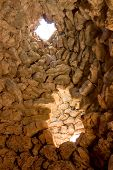 picture of nuragi  - light through a circular window nuraghe  - JPG