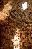 image of nuragi  - light through a circular window nuraghe  - JPG