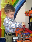 Boy With Toy Tools poster