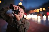 picture of pro-life  - Photographer taking photo with DSLR camera at night - JPG
