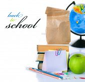 Back to School concept.School Books and green apple isolated on white