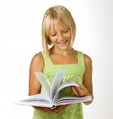 foto of little school girl  - School Girl reading the Book - JPG