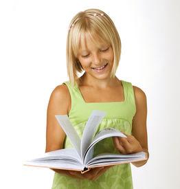 foto of little school girl  - School Girl reading the Book - JPG