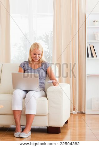 Portrait Of Smiling Woman Purchasing Online