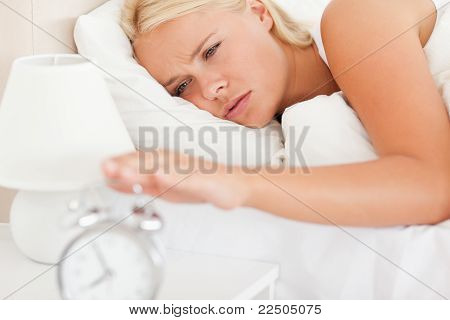 Woman Awaken By An Alarmclock