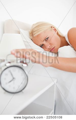Portrait Of A Tired Woman Awaken By An Alarmclock