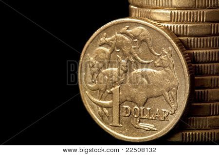 Australian dollar coins, over black background.