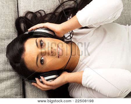 girl listening music on the sofa