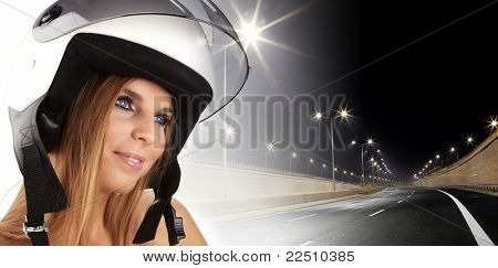 Sexy woman with a white motrcycle helmet and surprised expression