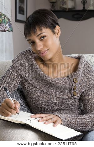 Young Woman Writing in a Journal