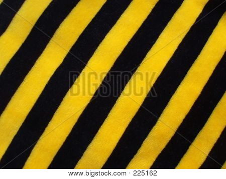 Fabric Of Black And Yellow Striped Velour