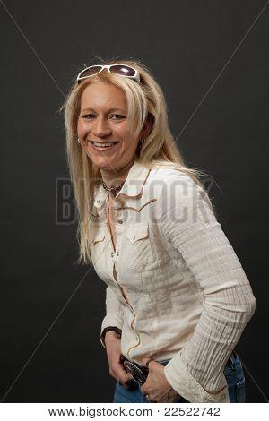 Blonde girl with sunglasses in studio