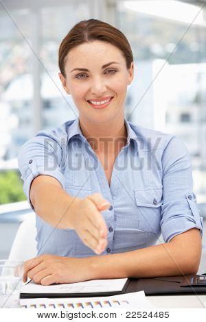 Businesswoman offering hand in greeting