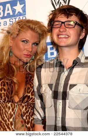 LOS ANGELES - AUG 11:  Beth Phoenix, Angus T. Jones arriving at the