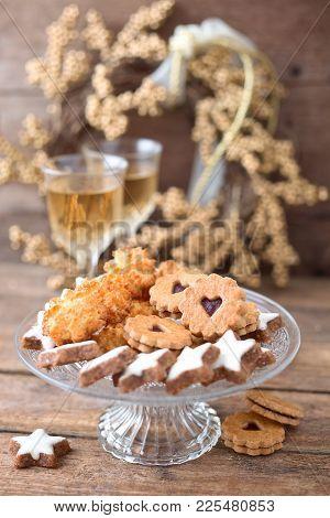 German Christmas Cookies Cinnamon Stars Coconut Macaroons And Linzer Cookies Poster