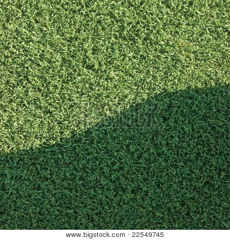 Artificial Grass Fake Turf Synthetic Lawn Field Macro Closeup With Gentle Shaded Shadow Area, Green