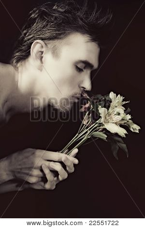 Young Men Sniffing Bouquet Of Flowers