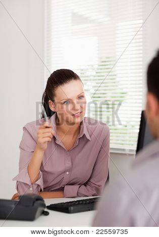 A businesswoman is talking to someone